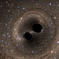 Cosa succede se due buchi neri si scontrano?