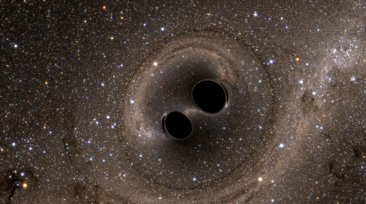 Cosa succede quando due buchi neri si scontrano?